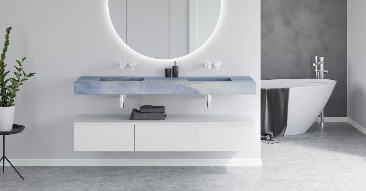 Blue macauba marble washbasin and freestanding luxury bathtub